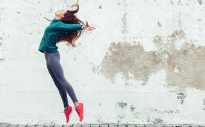 image of woman in fitness clothing jumping
